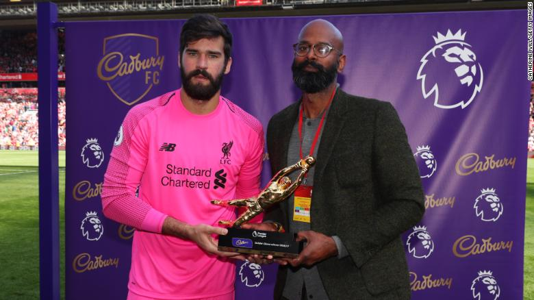 Alisson was handed the Premier League's Golden Glove trophy after the final game of the season.