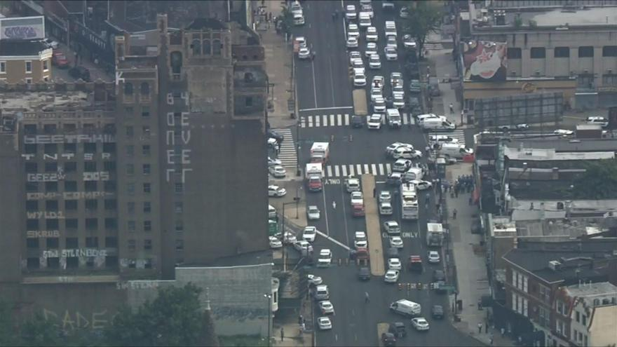 Police in standoff with barricaded shooter who wounded 6 Philadelphia officers; 2 officers trapped