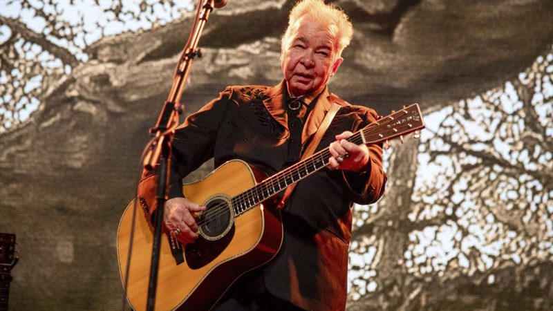 John Prine: singer-songwriter critically ill with Covid-19 symptoms, family says