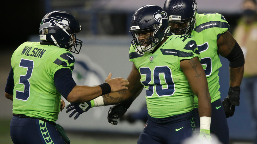 Wilson throws 2 TDs, Seahawks hold off Cardinals 28-21